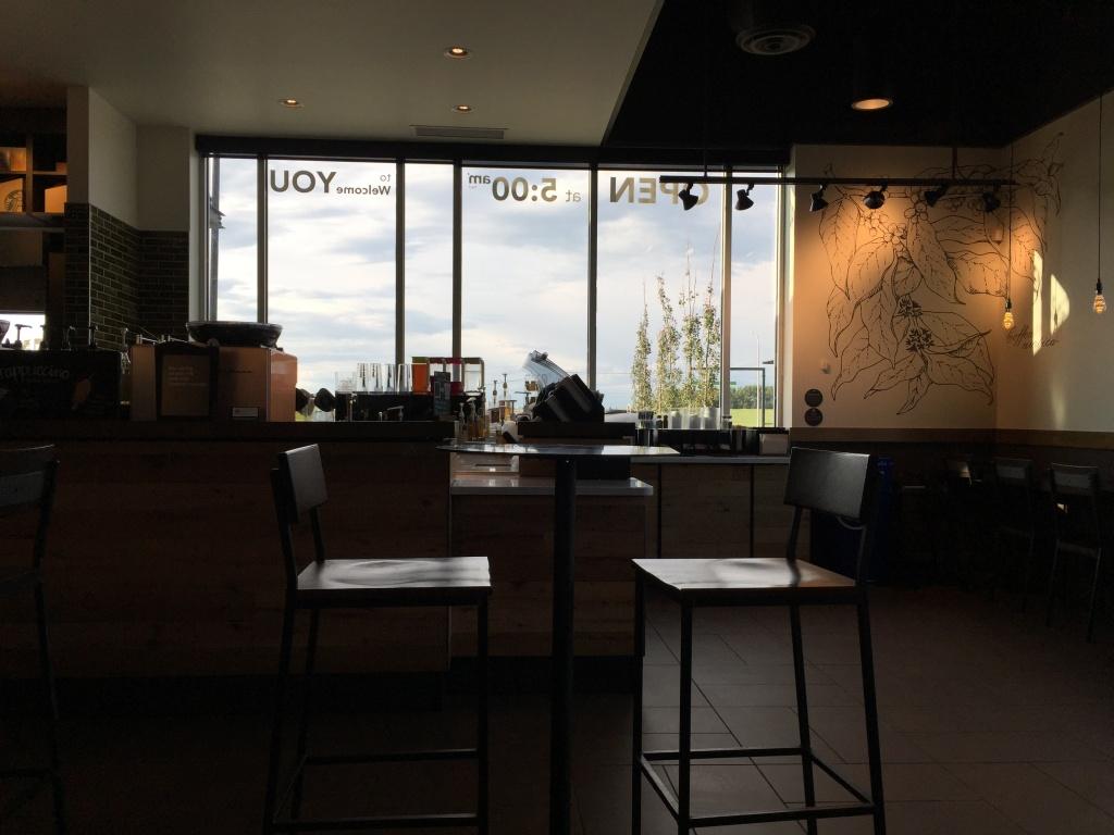 Starbucks interior with big windows.