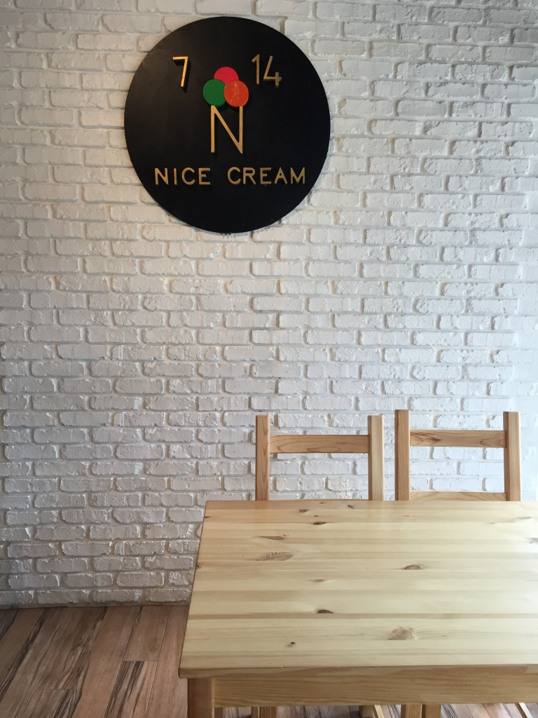 White brick wall and wooden furniture.