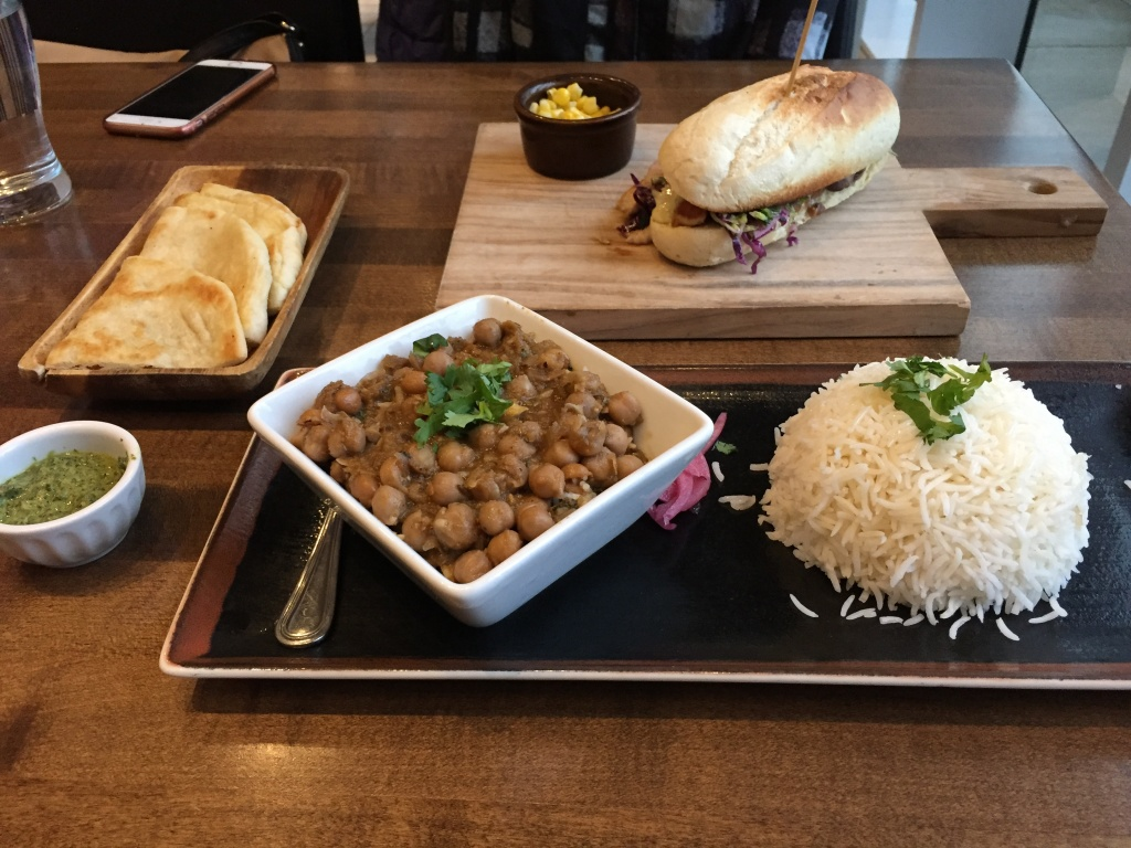Our meals ready! My chana masala with rice & naan, and the las tortas.