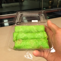 Pandan kuih/kueh with sweetened coconut shreds.